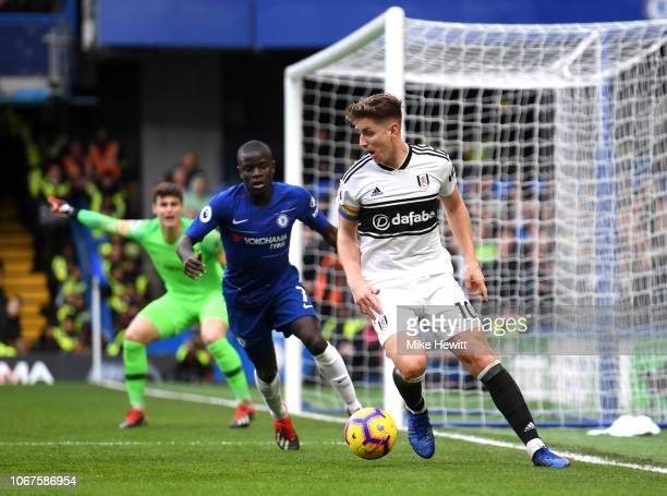 Tom Cairney of Fulham turns with the ball under pressure from N'golo Kante of Chelsea during the Premier League match between Chelsea FC and Fulham...