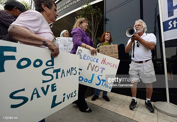 Tom Camarello with Progressive Democrats of America and members from several other organizations hold a rally in front of Rep Henry Waxman's office...