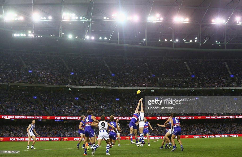 Tom Campbell of the Bulldogs and Todd Goldstein of the Kangaroos compete for the ball during the round six AFL match between the North Melbourne Kangaroos and the Western Bulldogs at Etihad Stadium on April 29, 2016 in Melbourne, Australia.