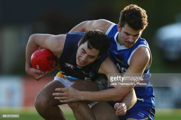 Tom Campbell of the Pioneers is tackled by Harrison Nolan of the Ranges during the round seven TAC Cup match between the Eastern Ranges and the...