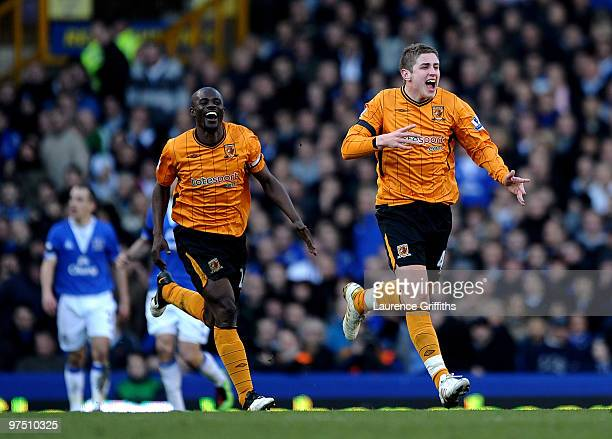 Tom Carney of Hull celebrates his goal with George Boateng during the Barclays Premier League match between Everton and Hull City at Goodison Park on...