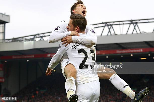 Tom Carroll and Gylfi Sigurosson of Swansea City celebrate scoring his sides third goal of the match during the Premier League match between...