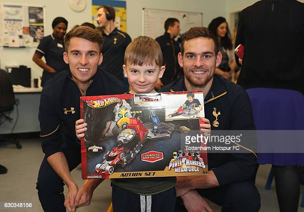 Tom Carroll and Vincent Janssen of Tottenham Hotspur pose for the camera with a young patient as they visit Whittington Hospital as Tottenham Hotspur...