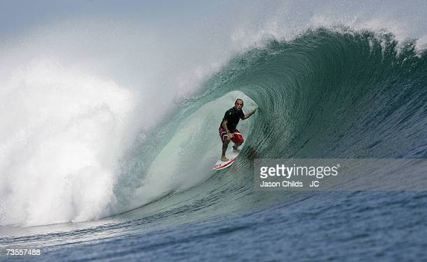 Tom Carroll from Australia rides the tube at Speedies Reef at GLand June 27 2006 in Grajagan Indonesia