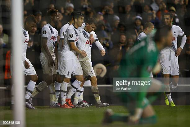 Tom Carroll of Spurs is congratulated by teammates after scoring his team's fourth goal and his first for the club during the UEFA Europa League...