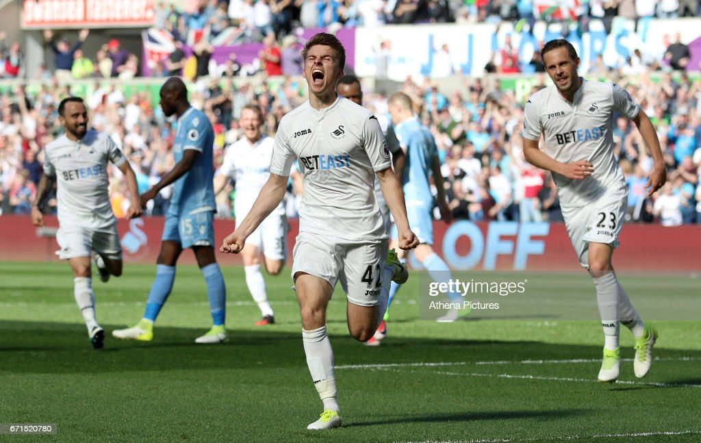 Tom Carroll of Swansea City celebrates scoring his sides second goal of the match during the Premier League match between Swansea City and Stoke City at The Liberty Stadium on April 22, 2017 in Swansea, Wales.