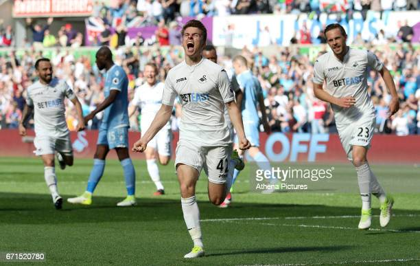 Tom Carroll of Swansea City celebrates scoring his sides second goal of the match during the Premier League match between Swansea City and Stoke City...