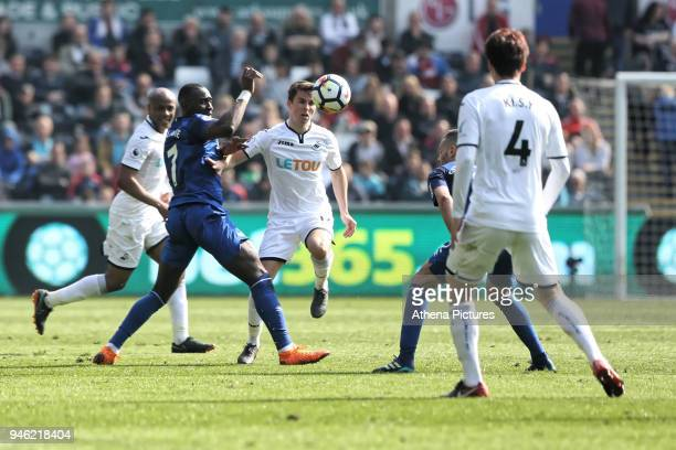 Tom Carroll of Swansea City controls the ball next to Yannick Bolasie of Everton during the Premier League match between Swansea City and Everton at...