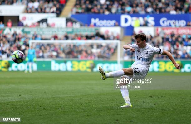 Tom Carroll of Swansea City crosses the ball into the box during the Premier League match between Swansea City and Middlesbrough at The Liberty...