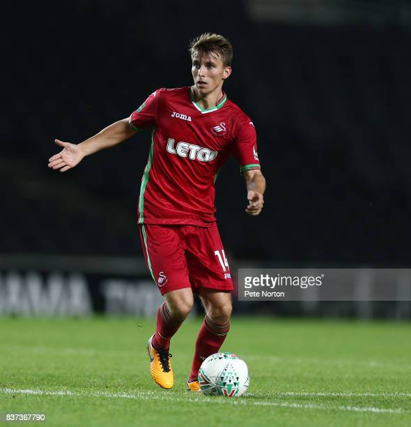 Tom Carroll of Swansea City in action during the Carabao Cup Second Round match between Milton Keynes Dons and Swansea City at StadiumMK on August 22...