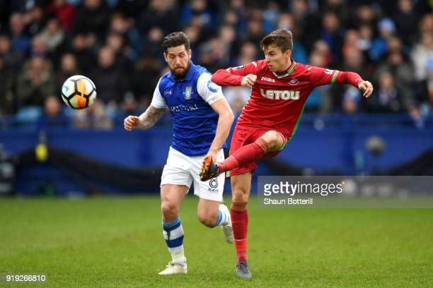 Tom Carroll of Swansea City is challenged by Jacob Butterfield of Sheffield Wednesday during the The Emirates FA Cup Fifth Round between Sheffield...