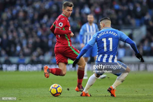 Tom Carroll of Swansea City kicks the ball back past Anthony Knockaert of Brighton during the Premier League match between Brighton and Hove Albion...