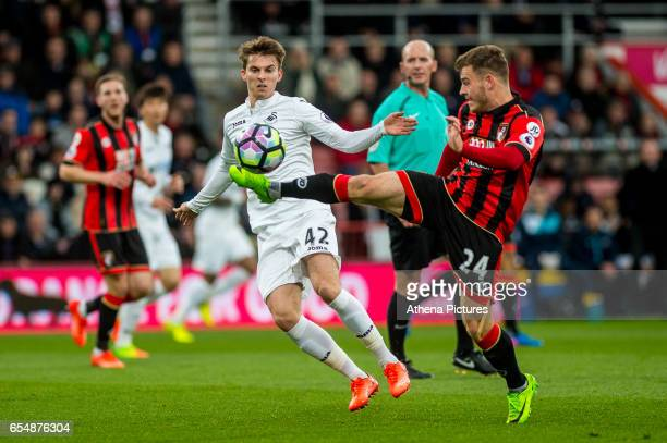 Tom Carroll of Swansea City looks on as Ryan Fraser of Bournemouth kicks the ball away during the Premier League match between AFC Bournemouth and...