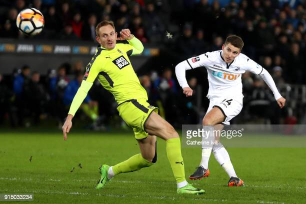 Tom Carroll of Swansea City scores his sides seventh goal during The Emirates FA Cup Fourth Round match between Swansea City and Notts County at the...