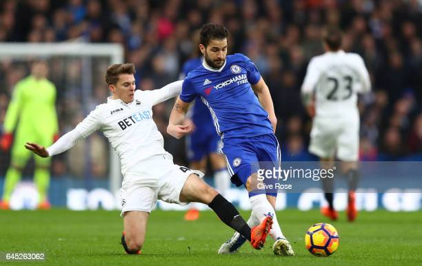 Tom Carroll of Swansea City tackles Cesc Fabregas of Chelsea during the Premier League match between Chelsea and Swansea City at Stamford Bridge on...