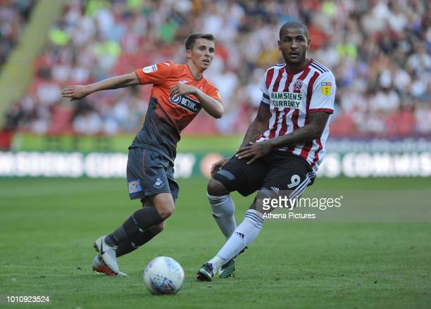 Tom Carroll of Swansea City vies for possession with Leon Clarke of Sheffield United during the Sky Bet Championship match between Sheffield United...