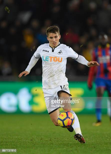 Tom Carroll of Swansea in action during the Premier League match between Swansea City and Crystal Palace at Liberty Stadium on December 23 2017 in...