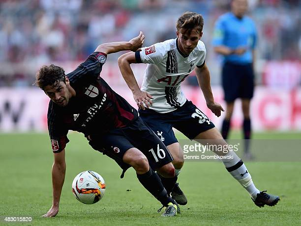Tom Carroll of Tottenham Hotspur challenges Andrea Poli of AC Milan during the Audi Cup 2015 match between Tottenham Hotspur and AC Milan at Allianz...