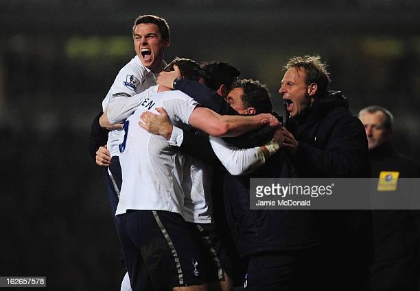 Tom Carroll of Tottenham Hotspur congratulates the winning goal scorer Gareth Bale with team mates during the Barclays Premier League match between...