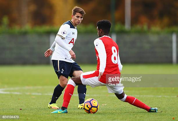 Tom Carroll of Tottenham Hotspur is closed down by Gedion Zelalem of Arsenal during the Premier League 2 match between Tottenham Hotspur and Arsenal...