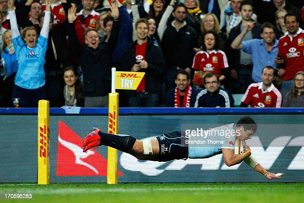 SYDNEY AUSTRALIA JUNE Tom Carter of the Waratahs dives to score a try during the match between the NSW Waratahs and the British Irish Lions at...