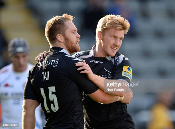 Tom Catterick celebrates scoring a try with Alex Tait of Newcastle Falcons during the Aviva Premiership match between Newcastle Falcons and Exeter...