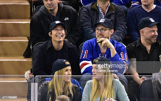 Tom Cavanagh and guest attend the Washington Capitals vs New York Rangers playoff game at Madison Square Garden on April 30 2015 in New York City
