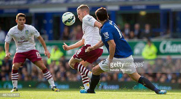 Tom Ceverley of Aston Villa is challenged by Gareth Barry of Everton during the Barclays Premier League match between Everton and Aston Villa at...