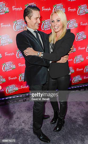 Tom Chambers and Camilla Dallerup arrive at the White Christmas press night after party at The Bloomsbury Ballroom on November 12 2014 in London...