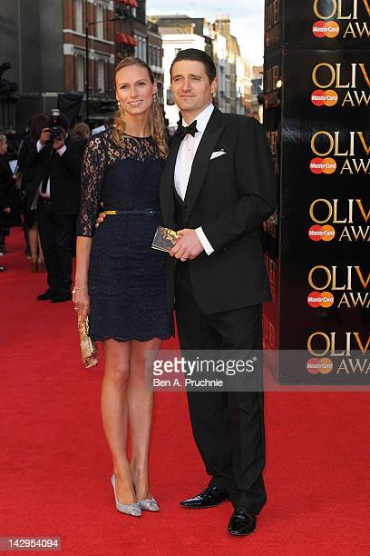 Tom Chambers and Clare Harding attend the 2012 Olivier Awards at The Royal Opera House on April 15, 2012 in London, England.