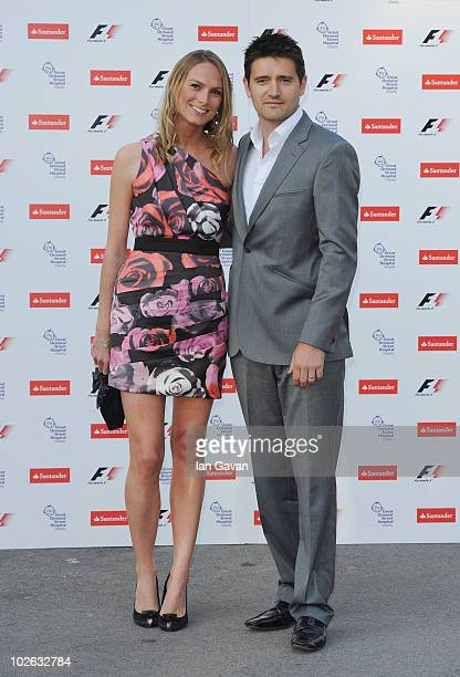 Tom Chambers and Clare Harding attend the F1 party in aid of Great Ormond Street Hospital Children's Charity at the Natural History Museum on July 5...
