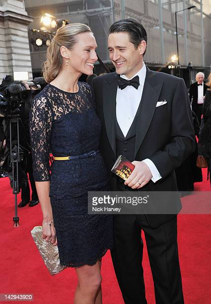 Tom Chambers and his wife Clare Harding arrive at the Olivier Awards 2012 at The Royal Opera House on April 15, 2012 in London, England.