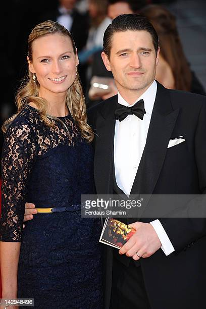 Tom Chambers and his wife Clare Harding arrive at the Olivier Awards at The Royal Opera House on April 15, 2012 in London, England.