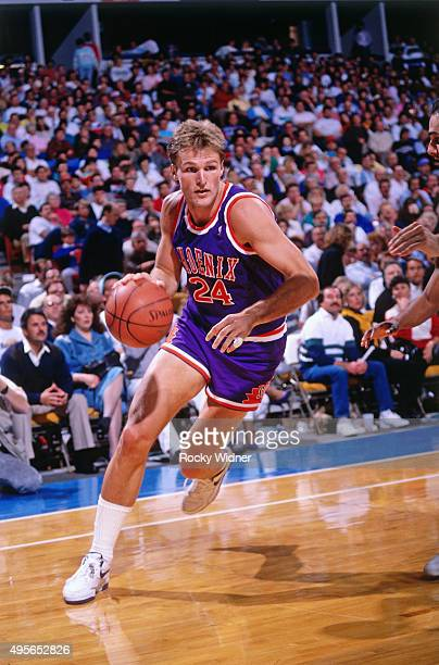 Tom Chambers of the Phoenix Suns dribbles against the Sacramento Kings circa 1991 at Arco Arena in Sacramento California NOTE TO USER User expressly...