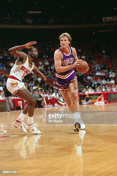 Tom Chambers of the Phoenix Suns drives to the basket against the Houston Rockets during an NBA game at the Summit circa 1990 in Houston Texas NOTE...
