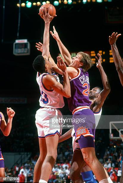Tom Chambers Of The Phoenix Suns Has His Shot Blocked By Pervis Ellison Washington