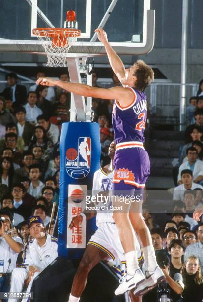 Tom Chambers of the Phoenix Suns in action against the Utah Jazz during an NBA basketball game circa 1990 at the Salt Palace in Salt Lake City Utah...