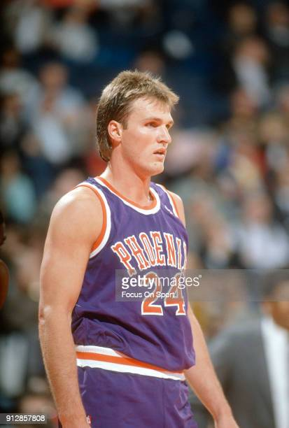 Tom Chambers of the Phoenix Suns looks on against the Washington Bullets during an NBA basketball game circa 1990 at the Capital Centre in Landover...