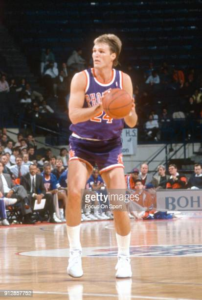 Tom Chambers of the Phoenix Suns looks to shoot against the Washington Bullets during an NBA basketball game circa 1990 at the Capital Centre in...