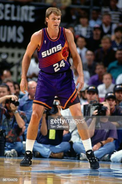 Tom Chambers of the Phoenix Suns plays defense against the Denver Nuggets circa 1993 at McNichols Arena in Denver Colorado NOTE TO USER User...