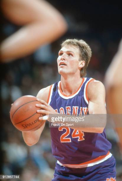 Tom Chambers of the Phoenix Suns shoots a free throw against the Washington Bullets during an NBA basketball game circa 1990 at the Capital Centre in...