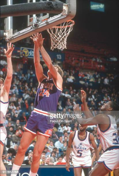 Tom Chambers of the Phoenix Suns shoots goes in for a layup against the Washington Bullets during an NBA basketball game circa 1990 at the Capital...