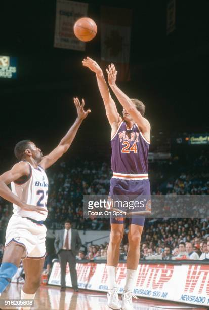 Tom Chambers Of The Phoenix Suns Shoots Over Charles Jones Washington Bullets During An