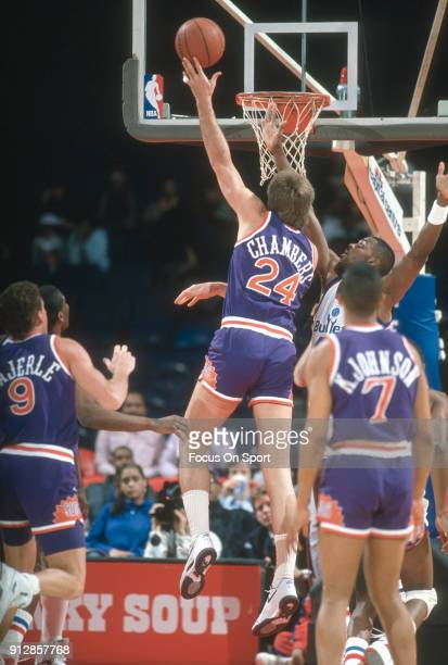 Tom Chambers of the Phoenix Suns shoots over Harvey Grant of the Washington Bullets during an NBA basketball game circa 1990 at the Capital Centre in...