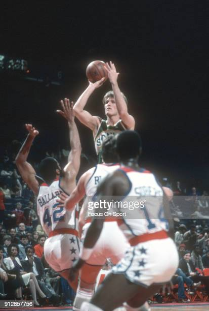 Tom Chambers of the Seattle Supersonics shoots over Greg Ballard of the Washington Bullets during an NBA basketball game circa 1984 at the Capital...