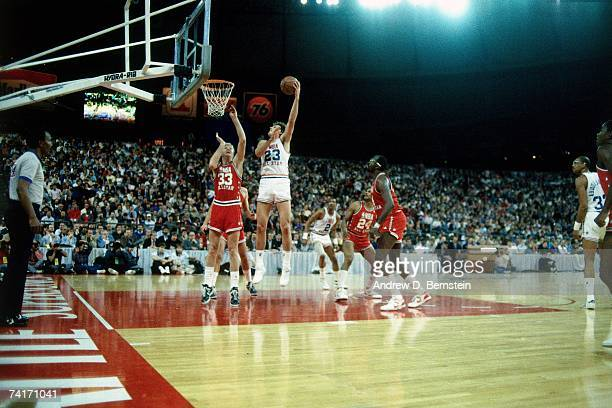 Tom Chambers of the Western Conference AllStars attempts a shot against Larry Bird of the Eastern Conference AllStars during the 1987 NBA AllStar...