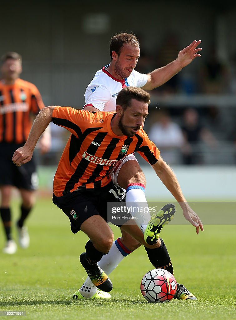 Tom Champion of Barnet holds off the challenge of Glenn Murray of Crystal Palace during a Pre Season Friendly between Barnet and Crystal Palace at The Hive on July 11, 2015 in Barnet, England.
