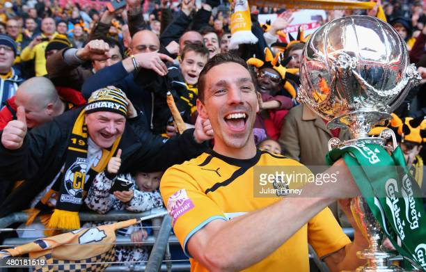 Tom Champion of Cambridge United celebrates with the supporters during the FA Carlsberg Trophy Final 2014 at Wembley Stadium on March 23, 2014 in...