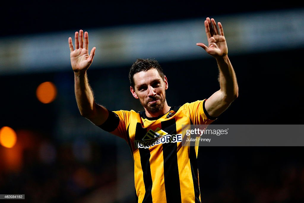 Tom Champion of Cambridge United salutes the fans after the FA Cup Fourth Round match between Cambridge United and Manchester United at The R Costings Abbey Stadium on January 23, 2015 in Cambridge, England.