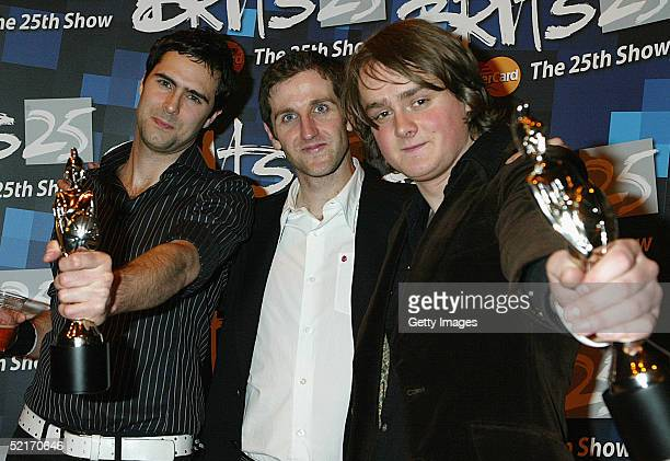 "Tom Chaplin, Tim Rice-Oxley and Richard Hughes of Keane pose with their awards for Best British Breakthrough Act and Best Album for ""Hopes and Fears""..."